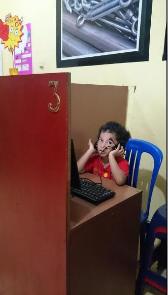 in front of computer 2